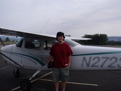 Eric Hamada in front of the plane that he soloed in.